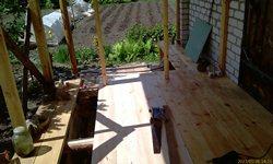 Веранда стройка вид на сад - увеличить